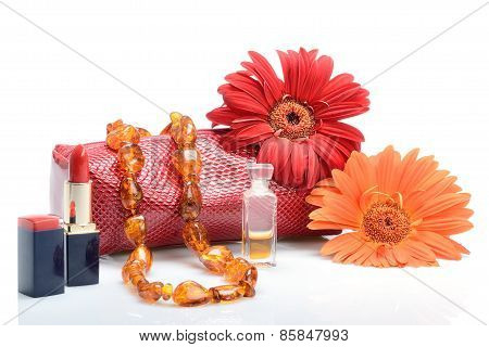 erbera flowers, cosmetics, perfumery and cosmetic bag female beads in still life