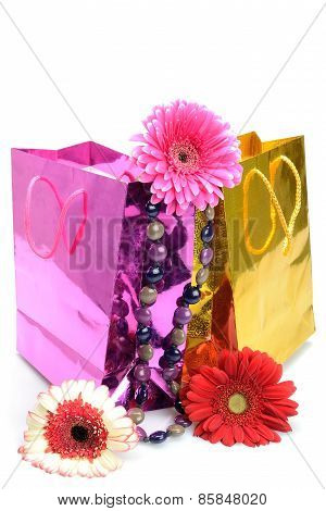 olorful gift bags, bead and flowers for the holiday still life