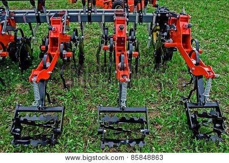 Agricultural Equipment. Disking, hoeing.