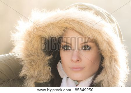 Beautiful Woman With Winter Coat Fur And Sunny Backlight Sun