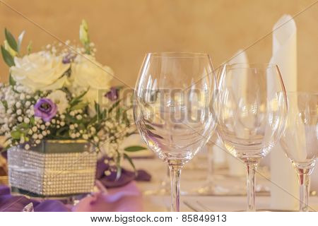 Premium Dinner Gala Table With Glasses Napkins And Flowers