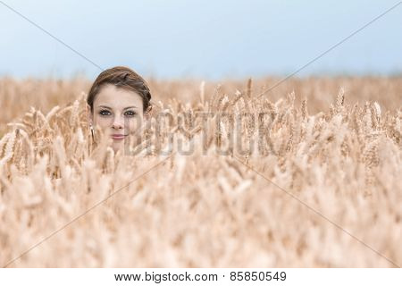 Funny Young Woman Hides Herself In Cornfield