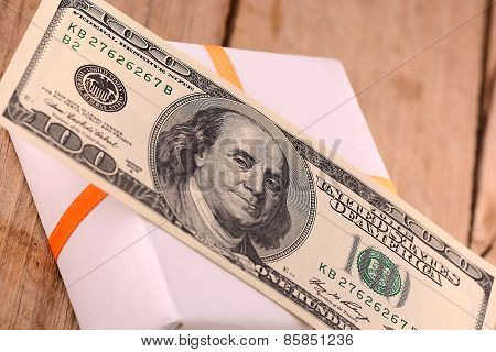 american money and white holiday gift box