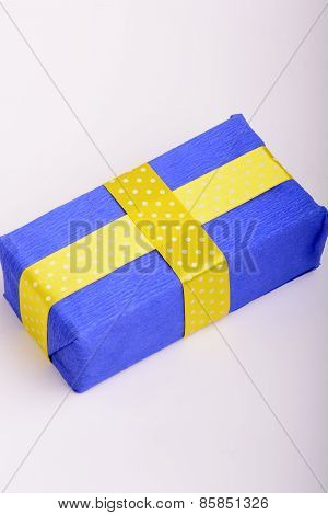 blue gift box with yellow ribbon over white