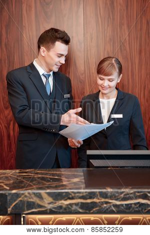 Hotel receptionists behind the counter
