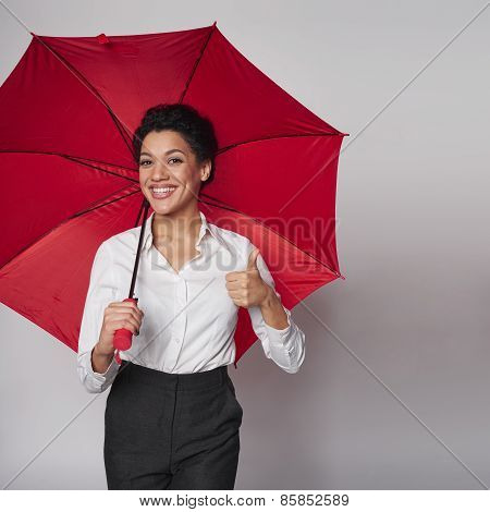 Happy woman with umbrella