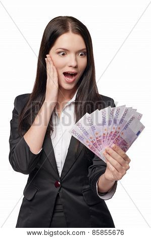 Excited woman with euro money in han