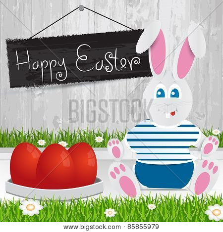 Easter Bunny. Happy Easter . Red Easter Eggs.the Grass With A Wooden Fence And Flowers.