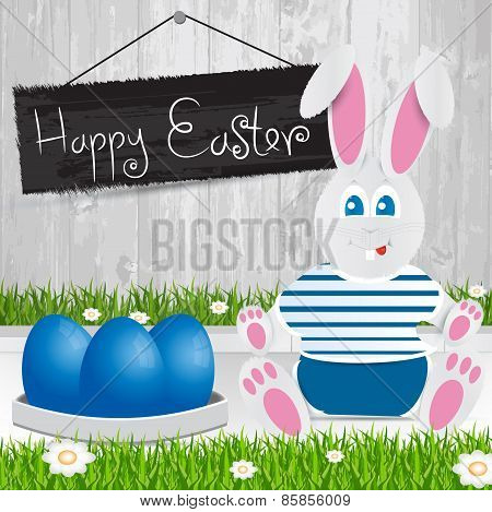 Easter Bunny. Happy Easter . Blue   Easter Eggs.the Grass With A Wooden Fence And Flowers.
