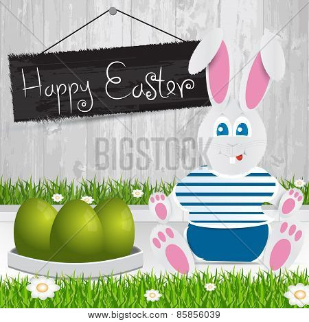 Easter Bunny. Happy Easter . Green  Easter Eggs.the Grass With A Wooden Fence And Flowers.