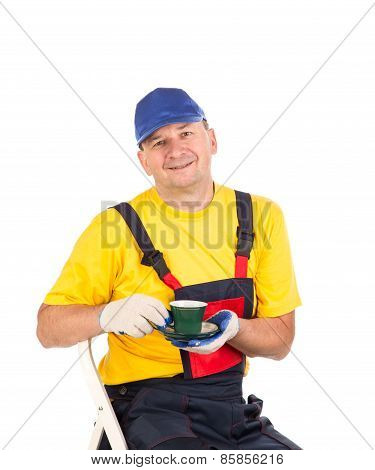 Worker with cup of tea.