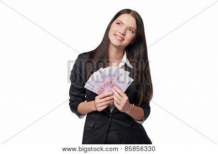 Dreamy woman holding euro money