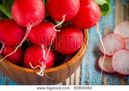 Bright Fresh Organic Radishes Closeup With Slices In The Bowl