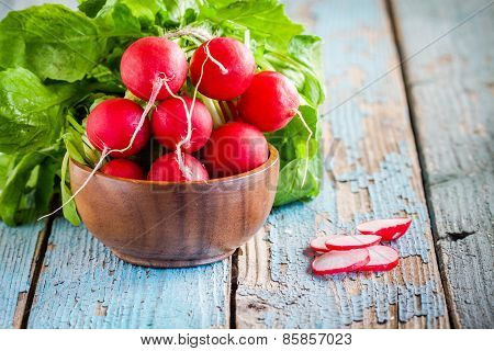 Bright Fresh Organic Radishes With Slices In The Bowl