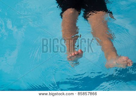 Front,  legs of drowning boy.