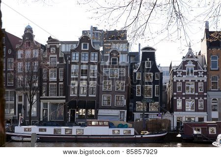 Canals Houses At The River Amstel And A House Boat