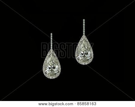 Diamond pearshapes earrings