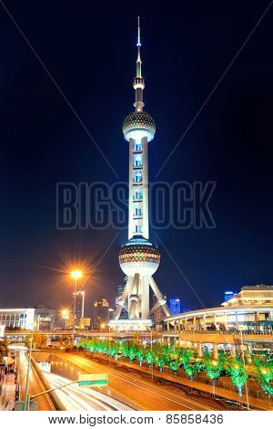 SHANGHAI, CHINA - JUN 1: Oriental Pear tower at night on June 1, 2013 in Shanghai. Shanghai is the largest city by population in the world of more than 24 million as of 2013.