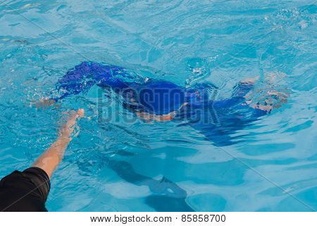 Boy hand helping drowning his brother