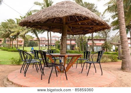 Tropical restaurant with straw sunshade umbrella