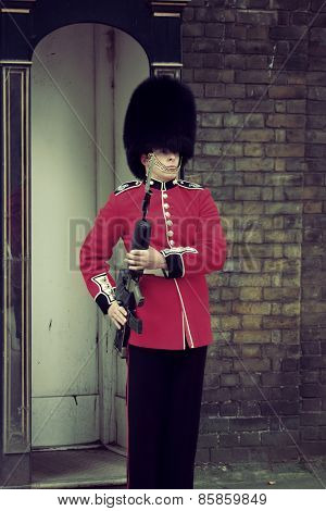 LONDON, UK - SEP 27: British Guard on duty on September 27, 2013 in London, UK. The ceremony is one of the top attractions in London and UK military traditions.