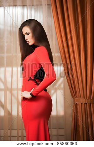 young attractive woman in long red dress