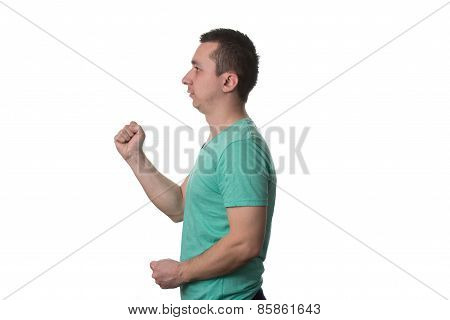 Portrait Of Angry Young Man Clenching His Fist