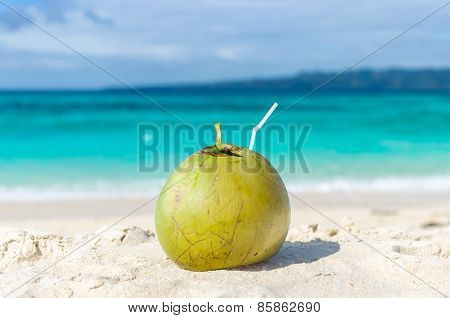 Tropical Green Coconut With Straw On White Exotic Sandy Beach