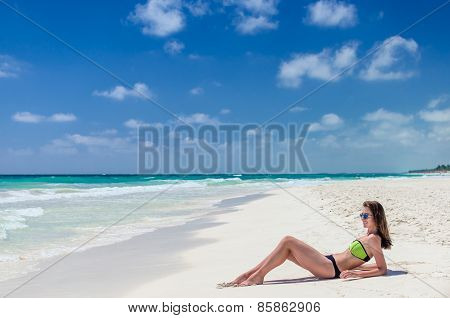 Young Cute Woman Lying And Getting Some Sun On Tropical White Sandy Beach