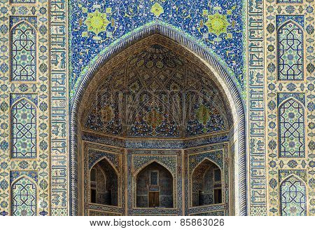 SAMARKAND, UZBEKISTAN - MARCH 14, 2015: Fragment of arch in Sherdor Madrasah (built in 1619-1636). It is one of the foremost interesting place in Central Asia