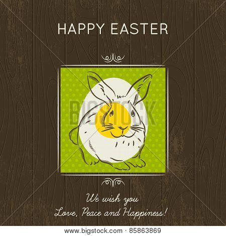Easter Card With Egg And Rabbit On Wooden Background.