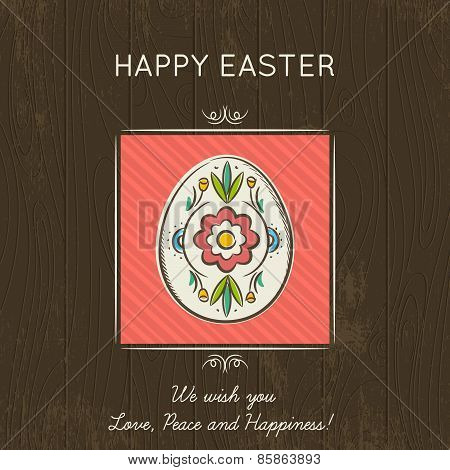 Easter Card With Colored Egg On Wooden Background.