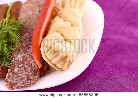 Salami With Pieces Of Cheese And Red Pepper