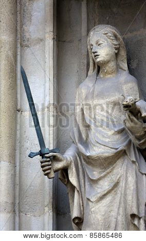 VIENNA, AUSTRIA - OCTOBER 11: Saint Justine of Padua, portal of the Minoriten kirche in Vienna, Austria on October 11, 2014.