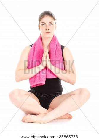 Front View Of Sitting Woman With Purple Towel, Hands Together And Mediating