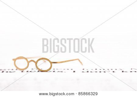 Tiny Reading Glasses On Text