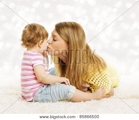 Mother Kissing Baby, Family Portrait, Mothers Kiss Little Kid, Child And Parent Love Concept