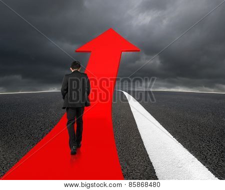 Businessman Walking On Arrow Road With Asphalt Pavement And Overcast