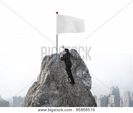 Businessman Hand Wanting For White Flag On Peak With Cityscape