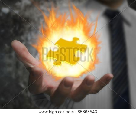 Burning Fire Ball Of Jigsaw Puzzle In Businessman Hand