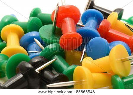Macro Of Colorful Push Pins On White Background