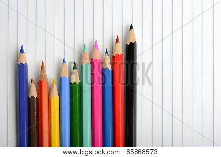 Coloring Crayons Arranged On A Sheet Of Notebook