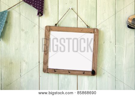 White Message Board Hanging On Retro Green Wooden Wall