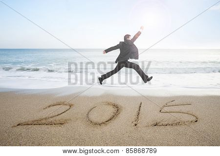 Businessman Jumping With New Year 2015 On Sand Beach