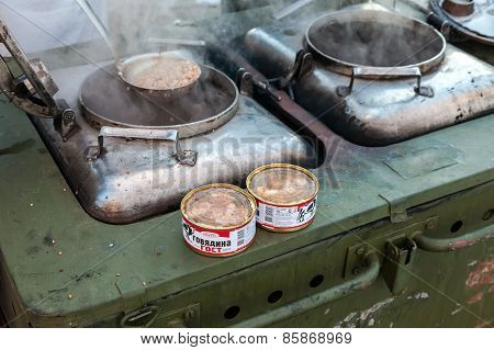 Cooking Food On A Military Field Kitchen In Field Conditions