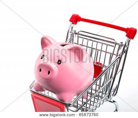saving concept, piggybank in cart - closeup