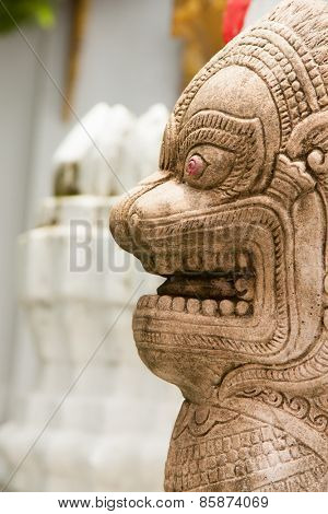 Stone statue of a lion-like creature in Thailand