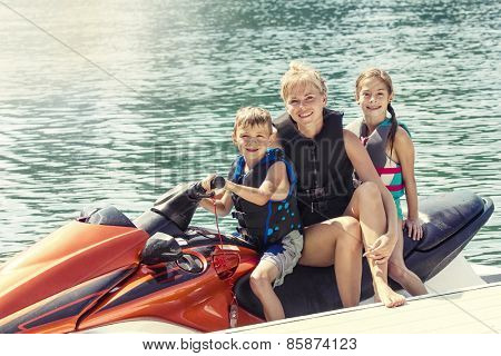 People enjoying a ride on a personal watercraft