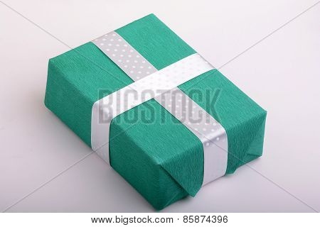 green gift box and white ribbon