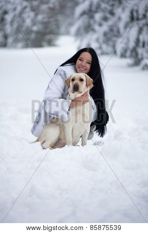 Beautiful Young Woman Playing With Labrador Dog
